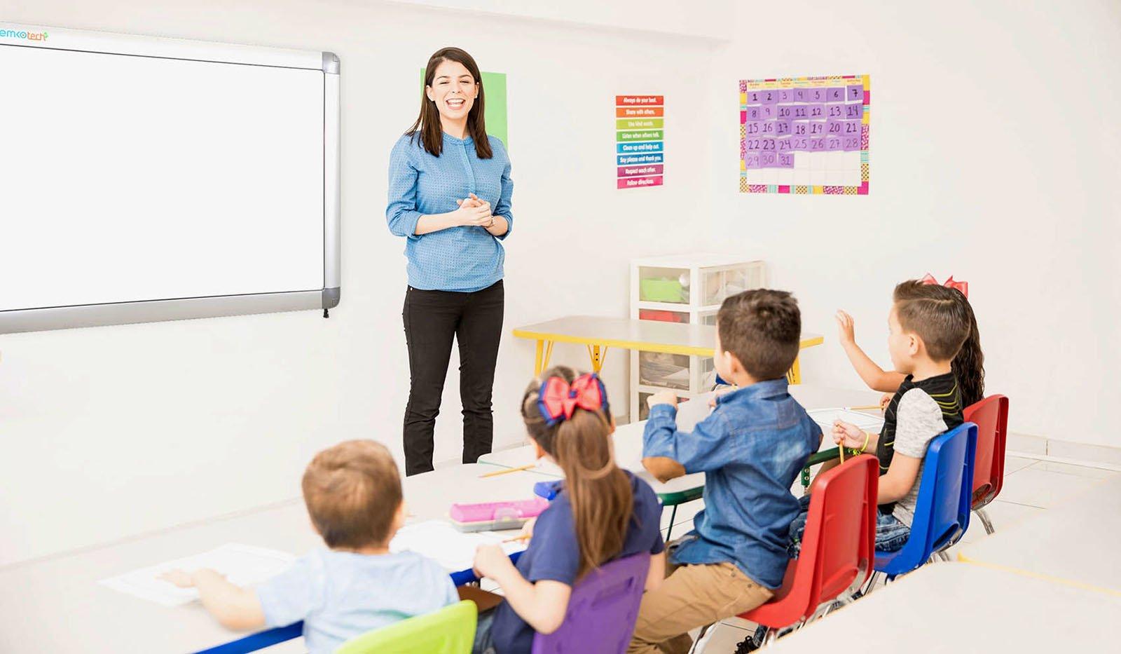 Pretty preschool teacher giving class